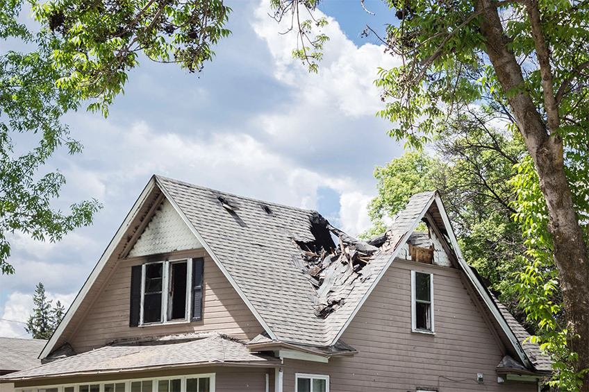 Storm damaged roof in need of repair from Xtreme Home Improvement