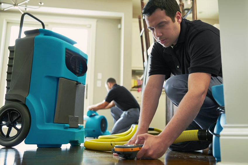 Xtreme Home Improvement Technicians cleaning a floor